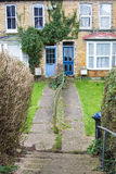Two front doors on terrace houses and path stock photo