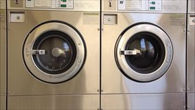 Two front loading washing machine tubs stock video