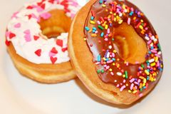 Two frosted donuts Stock Image