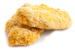 Two frozen bread crumbed chicken strips. Two frozen bread crumbed chicken strips on white stock image