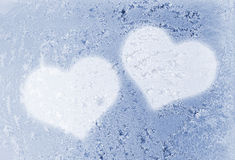 Two frozen hearts. Two hearts on the frozen glass Royalty Free Stock Photos