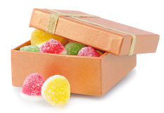 Two fruit candy lie near box Royalty Free Stock Photography