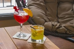 Two fruit cocktails in lounge stock photography