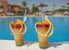 Two fruit cocktails by pool Royalty Free Stock Photo