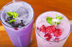 Two fruit smoothie drinks Royalty Free Stock Image