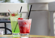Two fruity drinks with cherries on top Stock Photos
