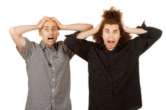 Two frustrated men. Two men grabbing their heads in frustration royalty free stock photo
