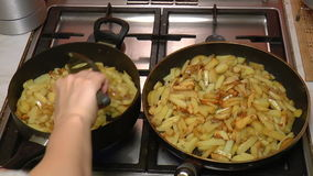 Two Frying Pan with French Fries. Closeup stock video footage