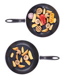 Two frying pans with vegetables. Royalty Free Stock Photos