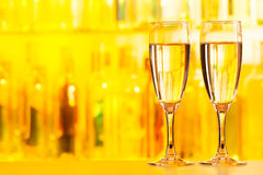 Two full flute glasses standing on bar counter Royalty Free Stock Photos