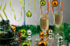 Two full glasses of champagne over color background.  royalty free stock images
