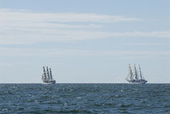 Two fullriggers and horizon. Two formidable windjammers at The Tall Ships´ Races start.  Fullriggers Sørlandet and Dar Młodzieży on the horizon. Almagrundet Royalty Free Stock Photography