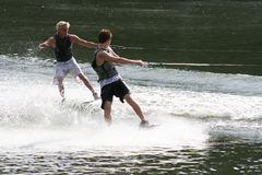 Two Fun. Two teenage boys having fun on the lake Royalty Free Stock Images