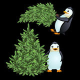 Two fun penguin carrying a green Christmas tree Stock Photo