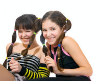 Two fun teen girls. Isolated on white royalty free stock photography