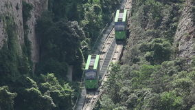 Two funicular cars. View of two funicular cabins on a cableway rail crossing stock video