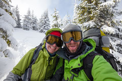 Two funnny hikers posing at camera in winter mountains Royalty Free Stock Images