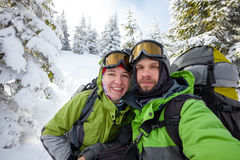 Two funnny hikers posing at camera in winter mountains Royalty Free Stock Photography