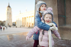 Two funny adorable little sisters outdoors in winter Royalty Free Stock Image