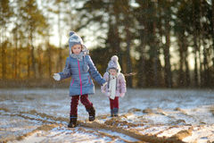 Two funny adorable little sisters winter park Stock Image