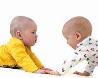 Two Funny Baby On A White Mattress Royalty Free Stock Image