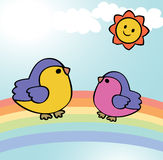 Two funny birds on rainbow Stock Photography