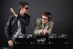 Two funny boys with dj booth. Photo of two funny boys with dj booth stock images
