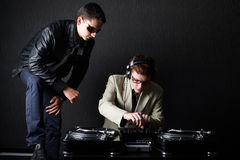 Two funny boys with dj booth. Photo of two funny boys with dj booth royalty free stock images