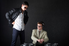 Two funny boys with dj booth. Photo of two funny boys with dj booth stock image
