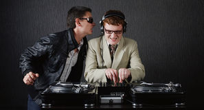 Two funny boys with dj booth. Photo of two funny boys with dj booth royalty free stock photo
