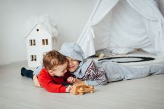 Two funny boys play together. Cute happy brothers smiling and having fun royalty free stock photos