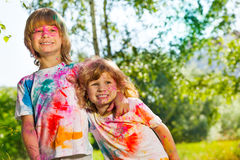 Two funny boys smeared with colored powder Royalty Free Stock Photos