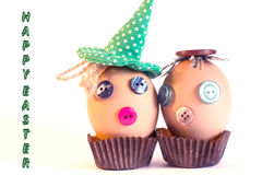 Happy easter. Two funny easter egg with eyes made of buttons Stock Photos