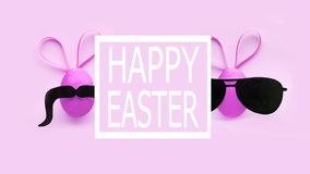 Two funny easter eggs with ears with glasses and a mustache. funny collage. banner quote happy easter stock image