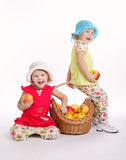 Two funny girls with apple harvest Stock Images
