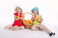 Two funny girls with apple harvest Royalty Free Stock Image