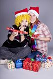 Two funny girls with christmas gifts. Stock Photo