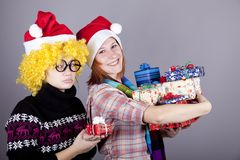 Two funny girls with christmas gifts. Royalty Free Stock Photos