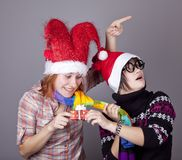 Two funny girls with christmas gifts. Stock Photos