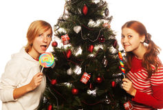 Two funny girls with lolly-pop. Royalty Free Stock Photo
