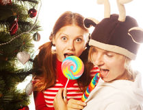 Two funny girls with lolly-pop. Royalty Free Stock Image