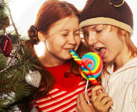 Two funny girls with lolly-pop. Royalty Free Stock Photos
