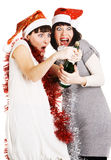 Two Funny Girls Opening A Champagne Bottle Royalty Free Stock Photography
