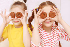 Two funny girls posing with cookies Royalty Free Stock Photo