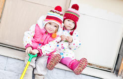 Two funny girls sitting. Outdoor stock photography