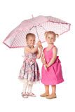 Two funny girs with umbrella Stock Photography