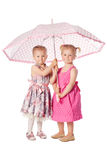 Two funny girs with umbrella Royalty Free Stock Photo