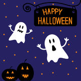 Two funny Halloween ghosts and pumpkins. Starry ni Stock Images