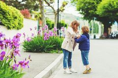 Little kids portrait. Two funny and happy kids playing together outdoors Royalty Free Stock Photos