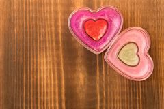 Two funny hearts on wooden background. The concept of Valentine`s day royalty free stock photography